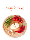 Mozzarella, tomatoes, pepperoni and herbs and text. Mozzarella, tomatoes, pepperoni and herbs on wooden board on white background and example text stock image