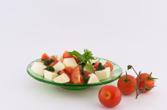 Mozzarella and Tomatoes. Salad of mozzarella and small tomatoes on white background stock photo