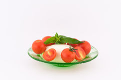 Mozzarella and Tomatoes. Mozzarella and small tomatoes on white background stock image