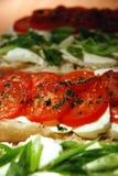 Mozzarella und Tomaten Stockbilder