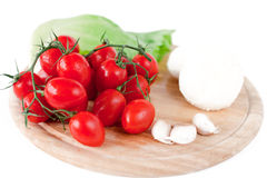 Mozzarella and vegetables on wooden board. Mozzarella and vegetables on white Stock Photo