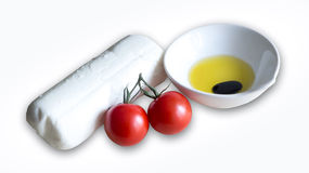 Mozzarellakäse und -tomaten lokalisiert Lizenzfreie Stockbilder