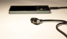 MP3 φορέας με τα ακουστικά Στοκ φωτογραφία με δικαίωμα ελεύθερης χρήσης