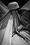 MP-40 and Helmet Hanging on a Tent Stock Photography