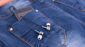 MP3 player and earphones Stock Images