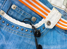 MP3 player in the jeans pocket Royalty Free Stock Image