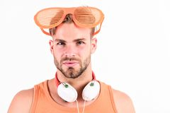 Mp3 player. sexy muscular man listen music on phone mp3 player. man with mp3 player on phone isolated on white. unshaven royalty free stock image