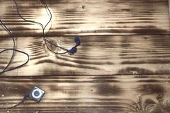 mp3 player on a wooden floor background vintage royalty free stock photo