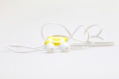 MP3 portable musical player and headphones Royalty Free Stock Photos