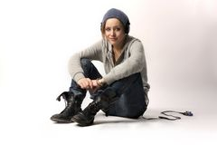 Mp3. Young pretty girl litening music with mp3 reader on a white background Royalty Free Stock Photos