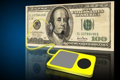 MP3 Headphones. A one hundred dollar bill with Franklyn wearing headphones Stock Photos