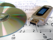 MP3 iPod music player. MP3 and iPod music player with cd and music sheet score Royalty Free Stock Image