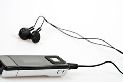 Mp3 player. Isolated mp3 player with headphones Royalty Free Stock Images