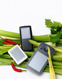 MP3 player. On vegetable, isolated on white Stock Image