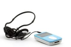 Mp3 player with headphones. Blue mp3 player with headphones on a white background Royalty Free Stock Photo