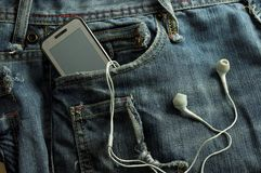 Mp3 player and  Mobile Phone  in a jeans pocket Stock Photography