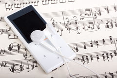 MP3 player and note Royalty Free Stock Photo