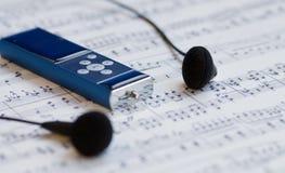 Mp3 speler en oortelefoons Stock Afbeeldingen