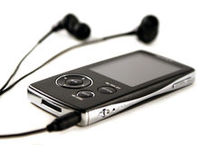 Mp4 player. A black mp4 player with a par of modern headphones Stock Photo