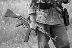 MP43 Submachine Gun. A world war two German soldier holding an MP43 submachine gun. Shot with minimum depth of field. Focus is on the hand and gun Royalty Free Stock Photography