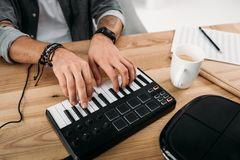 MPC pad. Cropped shot of musician playing on MPC pad royalty free stock images