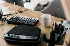 MPC pads. Close-up view of sound producer workplace with MPC pads and cup of coffee stock image