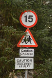 15mph and children at play road traffic signs Royalty Free Stock Photos