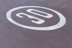 30mph or kmh road sign on the ground at an abstract angle Royalty Free Stock Image