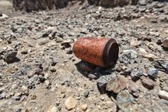 Rusty soda can on stony soil Royalty Free Stock Images