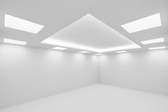 Еmpty white room with square ceiling lights wide view from corne. Abstract architecture white room interior - empty white room with white wall, white floor Stock Image