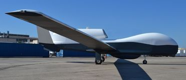 MQ-4C氚核寄生虫/间谍飞机 免版税图库摄影