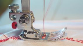 Máquina de coser metrajes