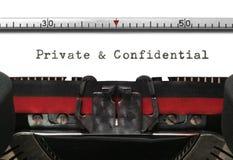 Máquina de escribir privada y confidencial Foto de archivo libre de regalías