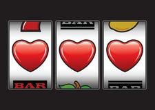 Máquina de ranuras triple de los corazones Imagen de archivo