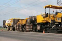 Máquina del asfalto Imagenes de archivo