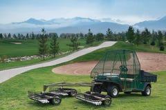 Máquina desbastadora e coletor da esfera de golfe Foto de Stock Royalty Free