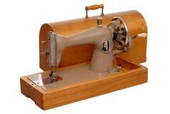 Máquina y caso de costura viejos Imagen de archivo