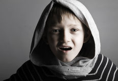 Mr attitude. A young blonde boy in a hood with a lot of attitude Royalty Free Stock Photography