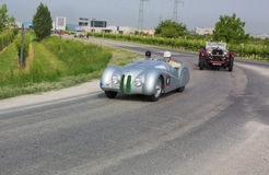 Mr Bean (Rowan Atkinson) at Mille miglia 2011. FORLI', ITALY - MAY 13: the actor Mr Bean (Rowan Atkinson) drive a BMW 328 Mille Miglia Roadster (1939) in stage royalty free stock photos