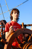 Mr.Captain. Young Man Aboard A Boat Royalty Free Stock Photo