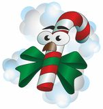 Mr. Christmas candy. Christmas candyman - candy with ribbon, eyes and mustache Stock Image
