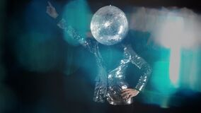Mr disco ball wearing silver jacket dancing in club