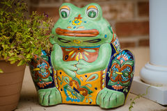 Mr frog guarding  the front porch. Stock Images