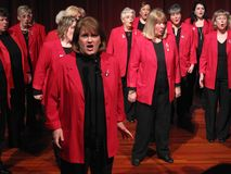 Mr. Grinch. Photo of a group of singers called the sweet adelines,  These singers are part of the harbor city music company show chorus and are performing at the Royalty Free Stock Image