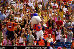 Mr. Met throws tee shirts. Royalty Free Stock Photography