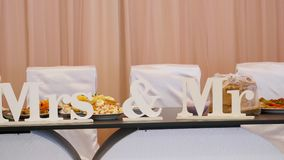 Mr. and Mrs. block letters on a table reserved for the bride and groom.  royalty free stock photos