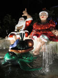 Mr. and Mrs. Claus sit on top waterfall Stock Photo