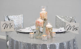 Mr. & Mrs. A picture of A bride & groom table set up with Mr. & Mrs. hanging from the two chairs Stock Photography