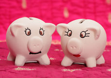 Mr and mrs piggy bank Stock Images