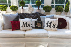 Mr and Mrs pillows on a couch at a wedding reception. Venue Stock Photo
